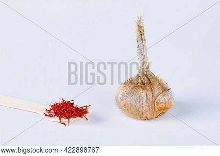 Sativus Crocus Bulb, Stamens Of Dry Spice Saffron On A White Background.