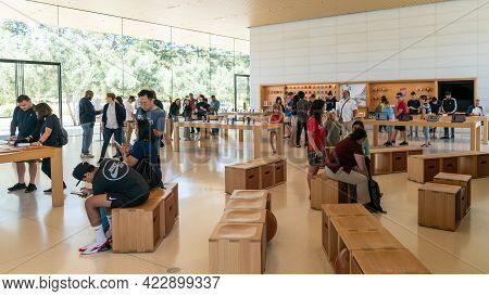 Cupertino, Ca, Usa - August 2019: Apple Store In Cupertino With People Examining Apple Products, App