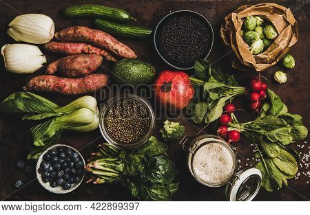 Vegetables, Grains, Greens And Fruit Over Dark Rusty Background