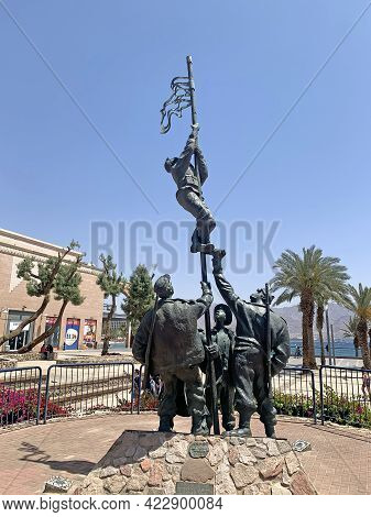 Eilat, Israel - April 15, 2021: Commemorative Sculpture Raising Of The Ink Flag - Group Of Fighters