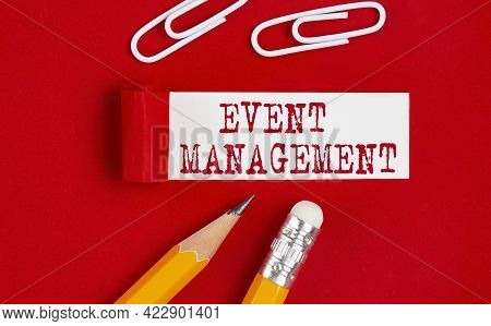 Event Management Message Written On The Torn Red Paper With Pencils And Clips, Business