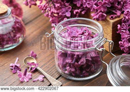 Lilac Flowers In A Jar, Bunch Of Syringa Flowers. The Preparation Of Infusion, Aromatic Sugar Or Jam