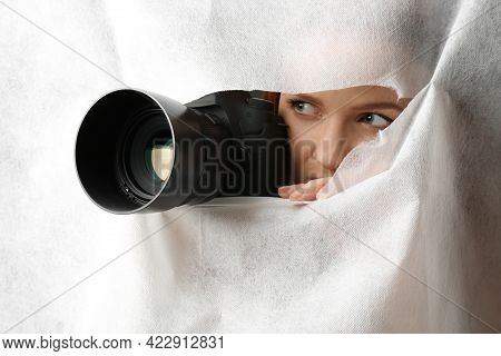 Hidden Woman With Camera Spying Through Hole In White Fabric