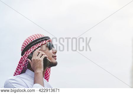 Islamic Man Using Smartphones App Organize Schedule Agenda  Focus On Hands Holding Smartphone Muslim