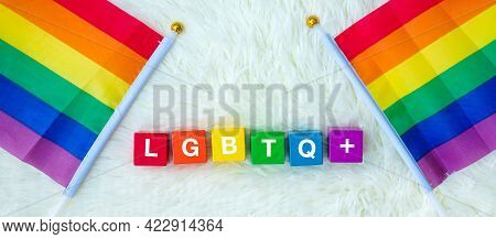 Lgbtq Rainbow Flag On White Background. Support Lesbian, Gay, Bisexual, Transgender And Queer Commun