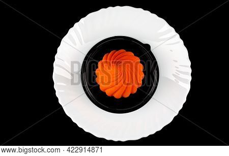 Beautiful Orange Cake On A White Plate On A Black Background.
