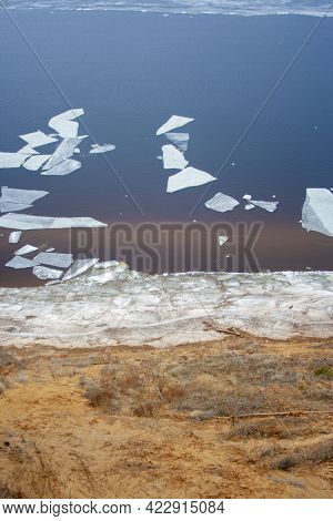 View Of The Volga River From A High Cliff In The Spring Afternoon. Melting Chunks Of Ice Float Throu