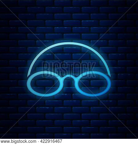 Glowing Neon Glasses And Cap For Swimming Icon Isolated On Brick Wall Background. Swimming Cap And G