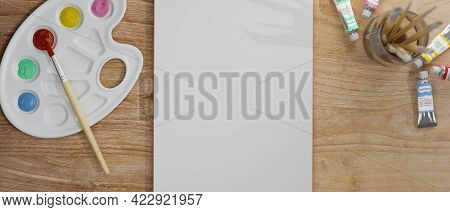 Artist Workspace With Blank Paper, Colour Palette And Paintbrush On Wooden Table, 3d Rendering, 3d I