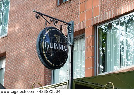 Bordeaux , Aquitaine France - 06 01 2021 : Guinness Sign Text And Logo Brand Of Irish Beer On Wall C