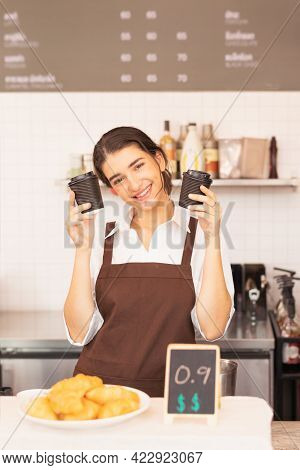 Vertical Angle Of Beautiful Caucasian Barista Woman Cheerfully And Holding Two Takeaway Hot Coffee C