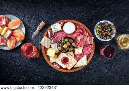 Charcuterie And Cheese Board, Overhead Flat Lay Shot With Copy Space On A Black Background. Italian