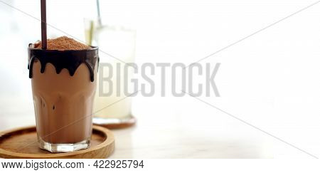 Cold Chocolate Drink With Melt Dripping Edge Decoration In Cozy White Modern Cafe Coffe Shop Style C