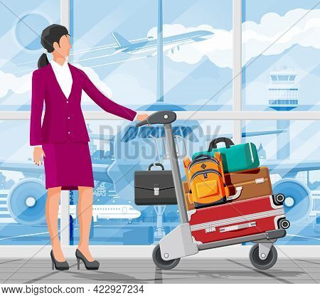 Woman And Hand Truck Full Of Bags In Terminal Interior. Glass Window Airfield. Airport Luggage Troll