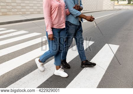 Cropped View Of Female Caregiver Assisting Visually Impaired Black Man With Cane Cross City Street,