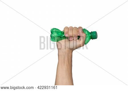 Plastic Bottle Recycling Or Pollution Concept. Hand Squeezing Or Crushing A Green Plastic Bottle Iso