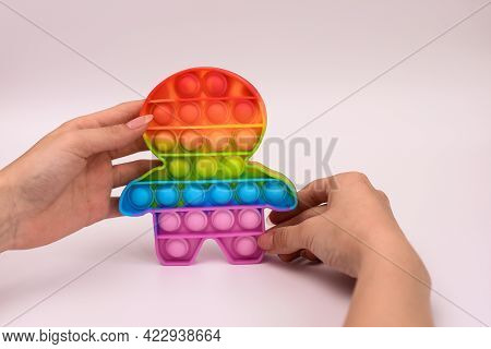 Touch Silicone Rubber Pop It On White Background. An Anti-stress Toy In Your Hands.