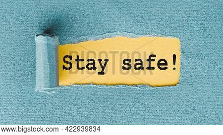 Stay Safe - Words Written Under Ripped And Torn Paper.