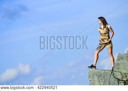 Brave Woman Stand Alone In High Mountains Blue Sky Background. Depression Concept. Soldier Girl. Mil
