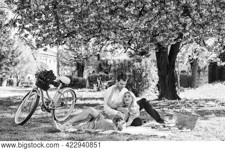 Blooming Garden. Perfect Spring Date. Romantic Picnic. Man And Woman In Love. Couple Sit Blanket. Ha