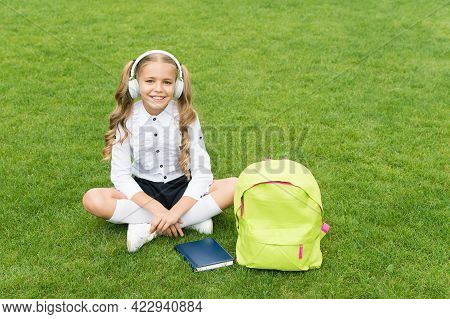 Take Your Listening Pleasure To A New Level. Happy Kid Listen To Music. Listening Comprehension