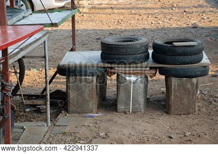 Stock Photo Of Recycle Old Damage Tyre And Rusty Steel Container As Sitting Bench At Indian Tea Stal