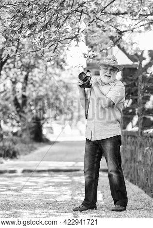 Naturalist Concept. Spring Holidays. Enjoying Free Time. Walking His Favorite Street. Senior Man Hol