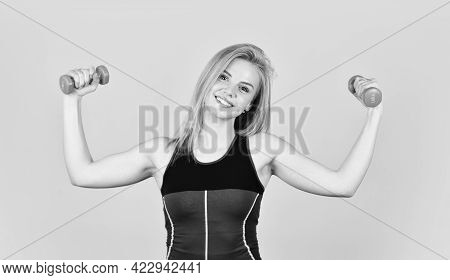 Fitness Girl Lifting Dumbbell In The Morning. Healthy Young Fitness Woman Doing Exercises With Dumbb