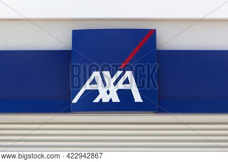 Reyrieux, France - May 28, 2017: Axa Insurance Logo On A Wall. Axa Is A French Multinational Insuran