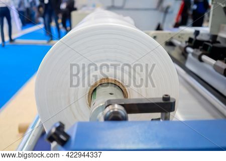 Side View: Moving Roller With Flat Polyethylene Transparent Film - Automatic Plastic Bag Making Mach