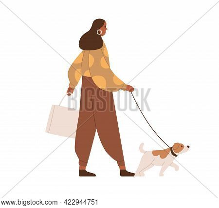 Young Woman Walking With Dog. Dark-skinned Person In Casual Clothes With Pet On Leash During Stroll.