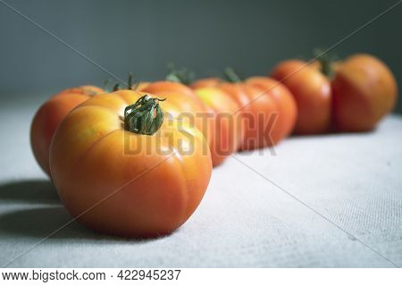 Group Of Uncooked Raw Red Tomatoes. Raw Food