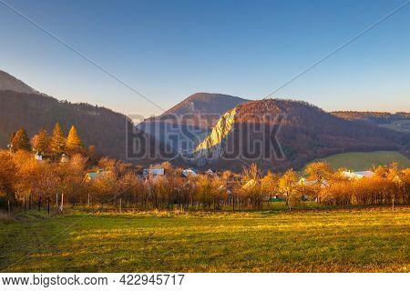 Mountainous Landscape In Autumn At Sunset. The Kostolec Village In Northwestern Slovakia, Europe.