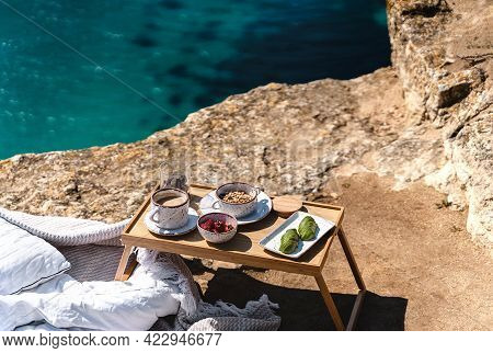 Beautiful Festive Breakfast With Seascape View On The Brink Of A Precipice. Travel And Healthy Lifes