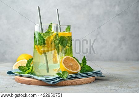 Refreshing Lemonade With Mint On A Gray Background. An Invigorating Summer Drink.