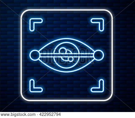 Glowing Neon Line Eye Scan Icon Isolated On Brick Wall Background. Scanning Eye. Security Check Symb