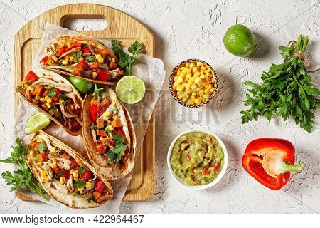 Tacos With Grilled Chicken Meat, Corn, Roasted Sweet Potatoes Cubes, Red Pepper  And Parsley Served