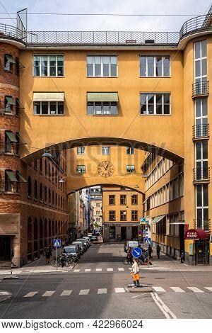 Stockholm, Sweden - May 25, 2021: Vertical Perspective View Of The Old Famous Orange Vintage Buildin