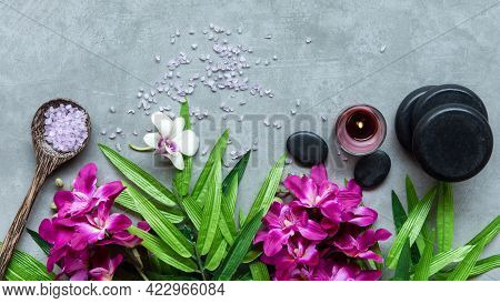 Thai Spa. Top View Of Hot Stones Setting For Massage Treatment And Relax With Purple Orchid On Black