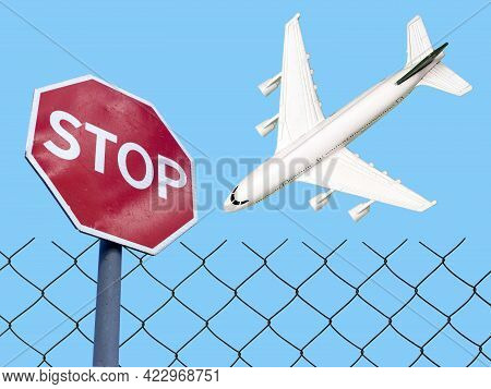 Flight Ban And Closed Borders For Tourists And Travelers. No-fly Zone Concept. Airplane In Flight Wi