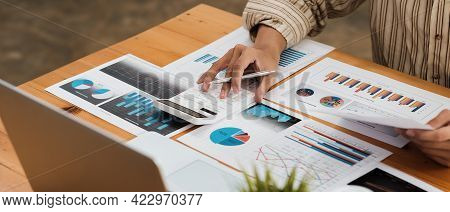Close Up Businessman Or Accountant Using Calculator To Calculating Bugget Finance, Tax, Accounting,