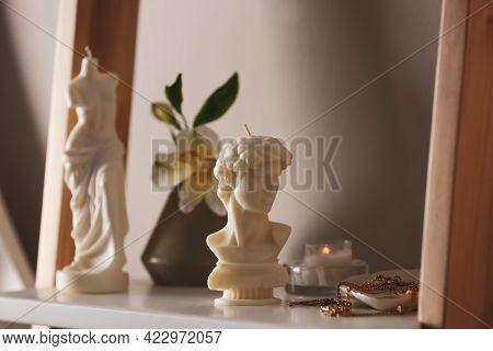 Beautiful David Bust Candle And Jewelry On Shelf
