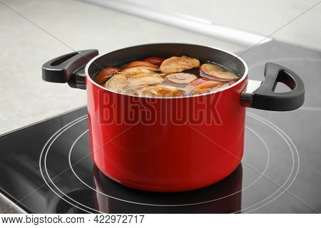 Pot Of Delicious Compot With Dried Apple Slices On Stove