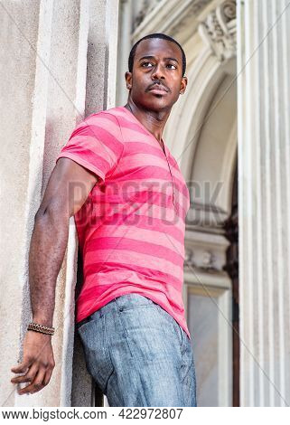 Young Man. Dressing In Red, Pink Lines T-shirt,  Gray Pants, Wearing A Bracelet, A Young Black Man I