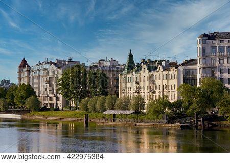 Houses On The Embankment Are Reflected In Srednyaya Nevka River Of Petersburg