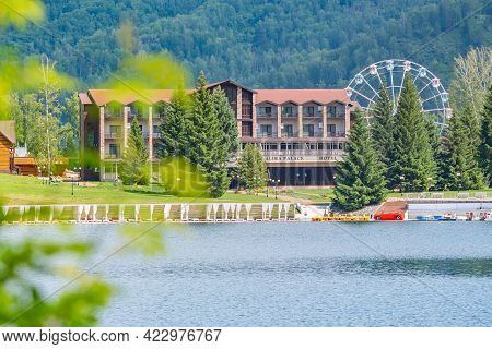 Lake Aya, Mountain Altai, Russia, 06.06.2021: Beautiful Landscape With The Hotel \