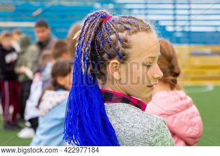 Ukraine, Khmelnytsky Region, Krasyliv. May 2021. Young Girl With Fashionable Hairstyle With Braided