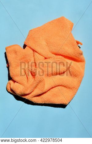 Orange Microfiber Cloth On Blue Paper Background