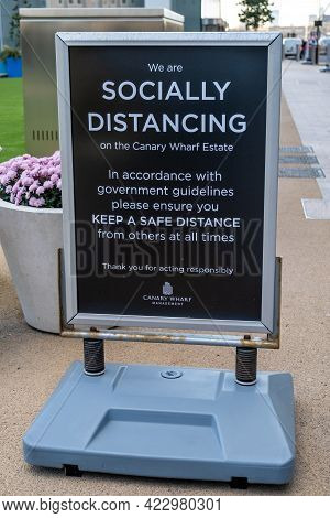London, Uk - November 4, 2020: A Sign In Canary Wharf Asking People To Follow Social Distancing Rule