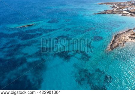 Greece, Cyclades. Aerial Drone View Of Rocky Coastline And Turquoise Color Sea Water
